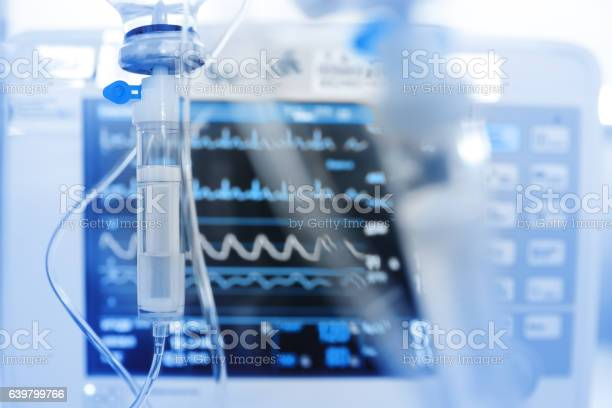 Iv Drip On The Background Of Monitoring Ecg Stock Photo - Download Image Now