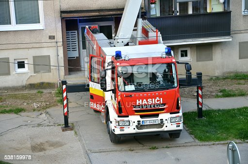 istock Iveco Eurocargo fire truck in action, some house in background. 538159978
