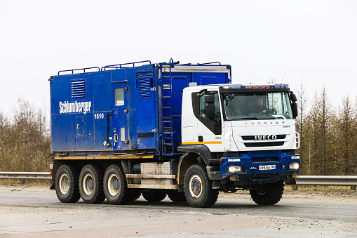 Novyy Urengoy, Russia - June 9, 2019: Schlumberger oil and gas service truck Iveco Trakker at the interurban road.