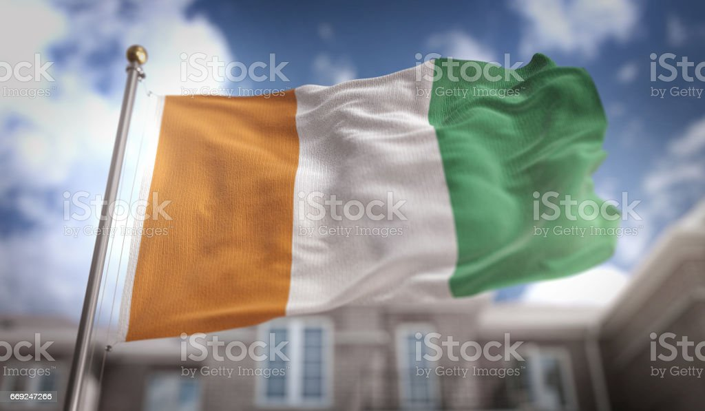 Ivory Coast Flag 3D Rendering on Blue Sky Building Background stock photo