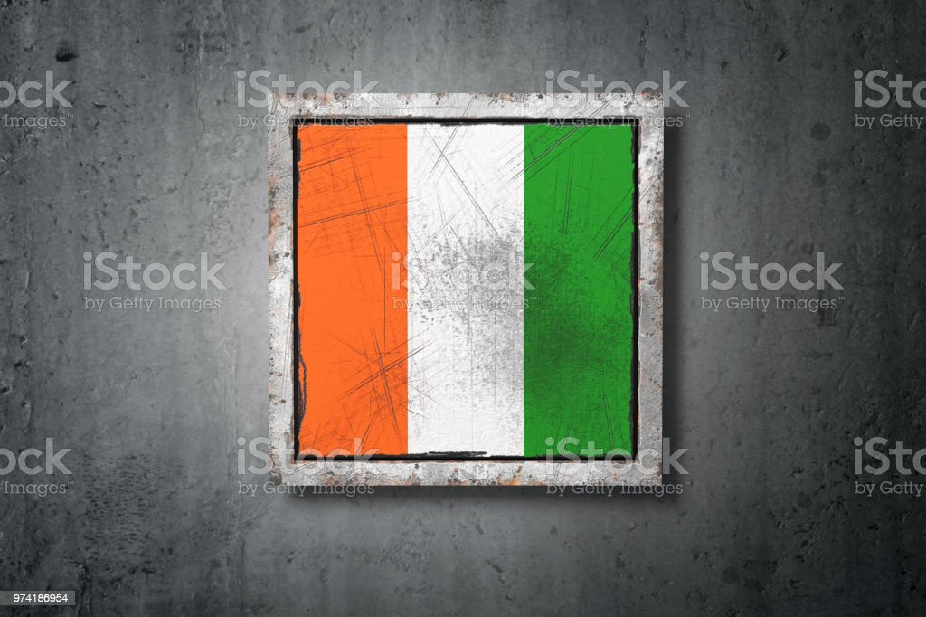 Ivory Coast flag in concrete wall stock photo