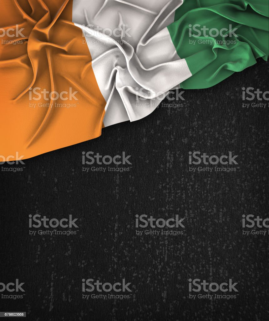Ivory Coast Flag Vintage on a Grunge Black Chalkboard With Space For Text stock photo
