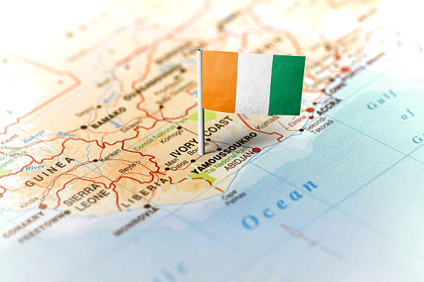 Ivory Coast pinned on the map with flag The flag of Ivory Coast pinned on the map. Horizontal orientation. Macro photography. côte d'ivoire stock pictures, royalty-free photos & images