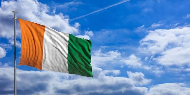 Ivory Coast waving flag on blue sky. 3d illustration Ivory Coast waving flag on blue sky background. 3d illustration côte d'ivoire stock pictures, royalty-free photos & images