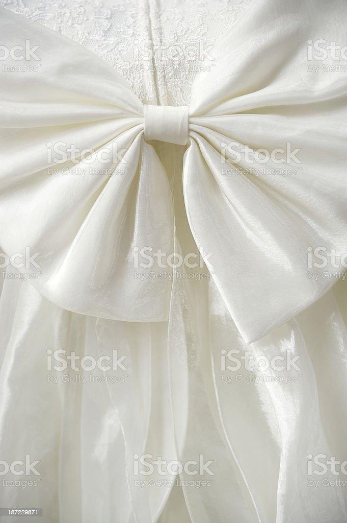 Ivory White Wedding Dress Bow Detail Close-Up royalty-free stock photo