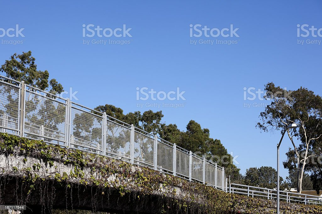 Ivy grows beneath a railing on a freeway overpass. royalty-free stock photo
