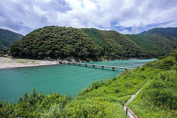 Iwama Low Water Crossing (Kochi Prefecture Shimanto) in Japan Iwama Low Water Crossing (Kochi Prefecture Shimanto) in Japan sunken stock pictures, royalty-free photos & images