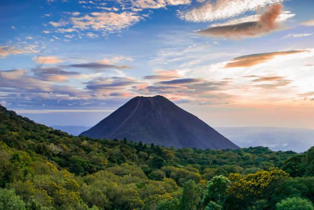 Izalco volcano in El Salvador A volcano with beautiful clouds around it in El Salvador, Central America central america stock pictures, royalty-free photos & images