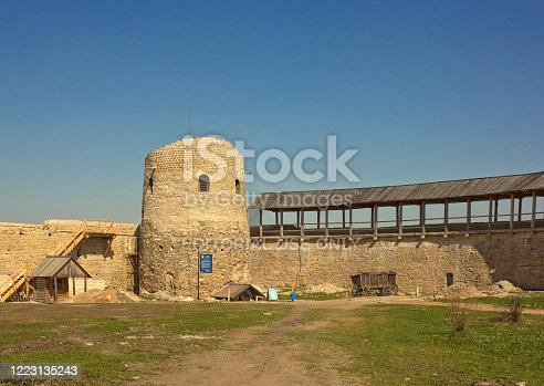 Izborsk, Russia - May 09, 2013: Inner yard of medieval fortress with wall and tower