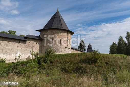 Izborsk Tower with fortress wall of Holy Dormition Pskovo-Pechersky Monastery. Pechory, Russia