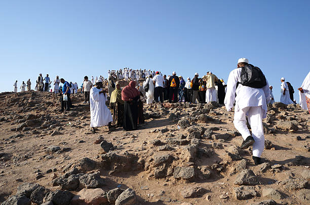 Jabal Uhud is one of historical place in Islamic history. MEDINA, SAUDI ARABIA - SEPT 21 : pilgrims flocked hiking uphill of Jabal Uhud in September 21, 2013 in Medina, Saudi Arabia. Jabal Uhud is one of historical place in Islamic history. circumambulation stock pictures, royalty-free photos & images