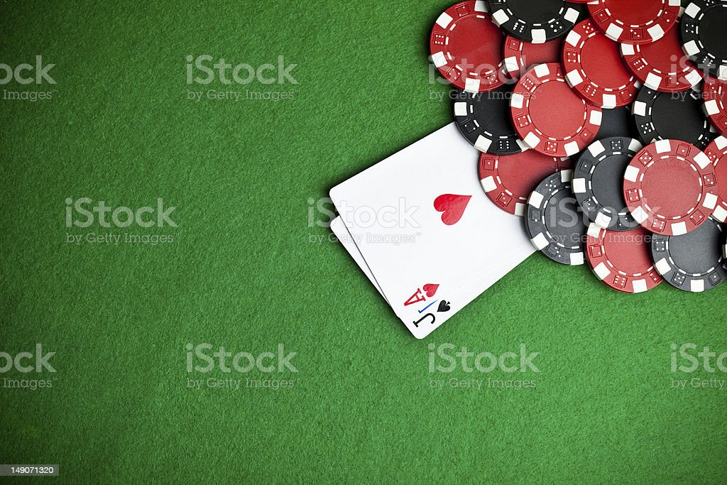 Jack and ace with a pile of poker chips on a poker table stock photo