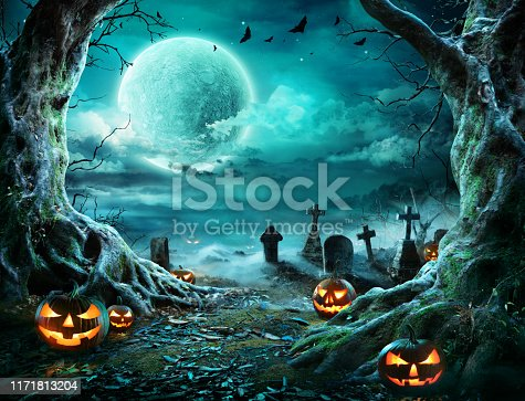 Jack 'O Lantern In Cemetery In Spooky Night With Full Moon