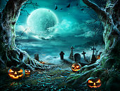 istock Jack 'O Lantern In Cemetery In Spooky Night With Full Moon 1171813204