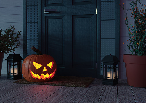 High resolution digital image of a Jack o' Lantern sitting on a mat, on the front porch of  a residence, next to the door. Plenty of text space.