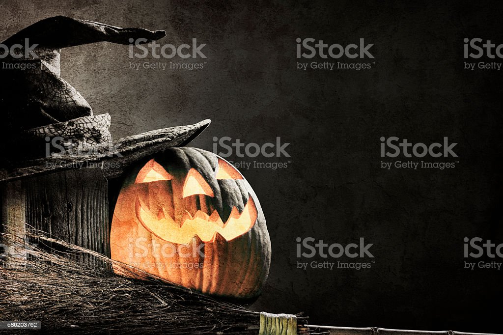 Jack O' Lantern Next To Witch's Hat And Witch's Broom stock photo