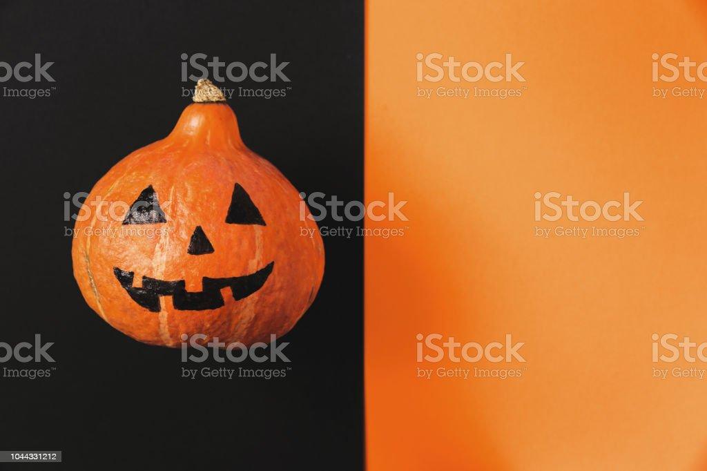 Aerial portrait of Jack O\' Lantern on black and orange background