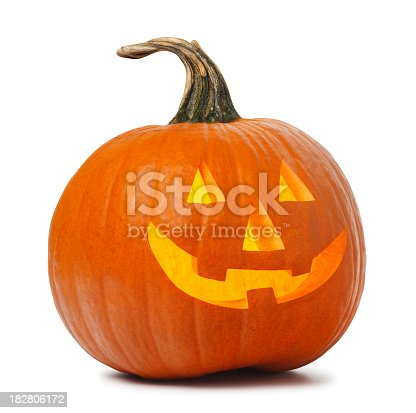 A jack O' Lantern on white. Clipping path included.  The jack O' Lantern glows with a warm light and the wistful curve of the stem makes this pumpkin the ideal jack O' Lantern.  It stands ready to for Halloween and the tradition of Trick-Or-Treat.  The jack O' Lantern is carved with the traditional eyes, nose, and smile.