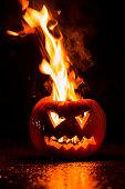 Scary Jack O' Lantern in fire. Halloween theme.