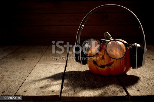 istock jack o lantern with headphones and spectacles 1022920240