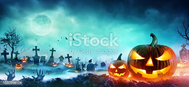 Pumpkin And Zombie hand In Cemetery