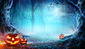 istock Jack O' Lanterns In Spooky Forest At Moonlight - Halloween 1177824148