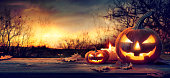 istock Jack O' Lanterns In Spooky Forest With Ghost Lights - Halloween Background 1173594824