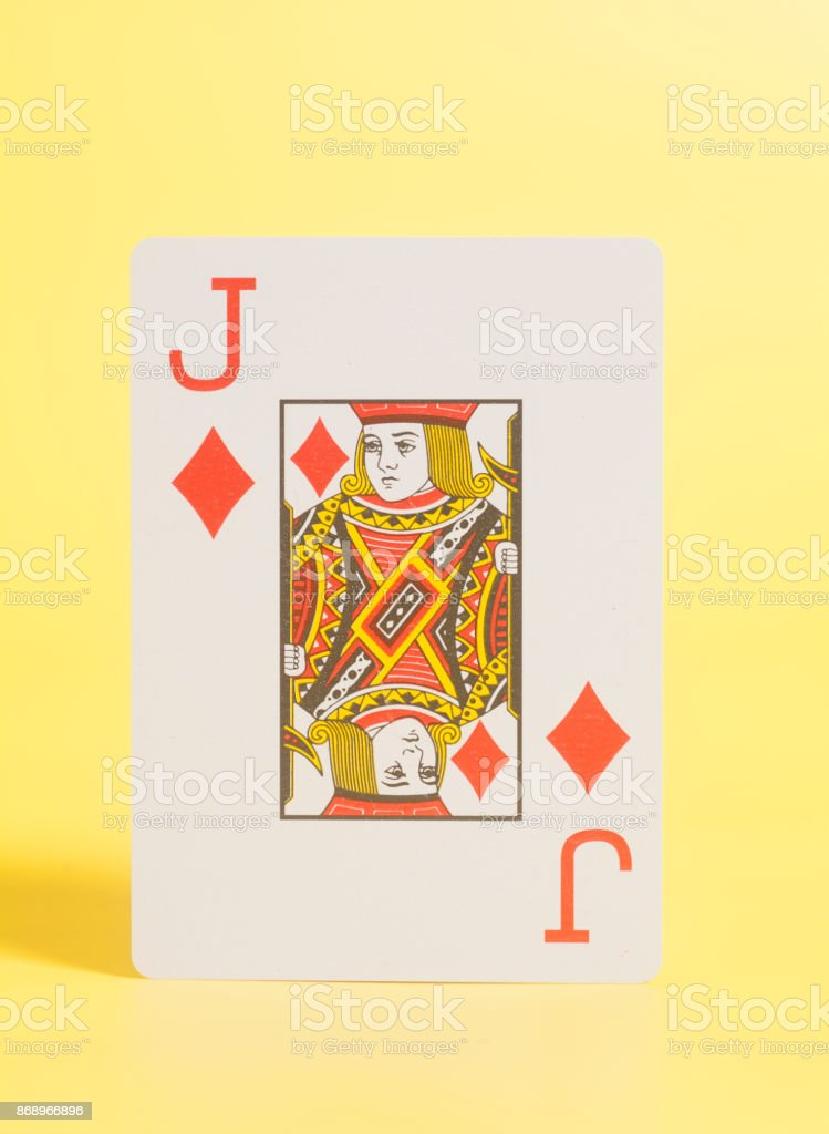 Jack of hearts playing card on a yellow background stock photo