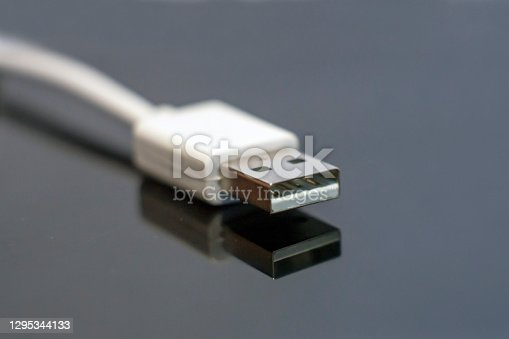 View of a 5V white USB jack in gray background.