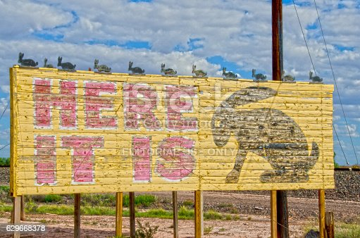 Joseph City, United States - September 3, 2016: Another leftover from the heydays of Route 66 are several businesses that are still in operation today.  They've retained their kitschy 1950's look, as well.  Here is a classic:  a billboard for the Jack Rabbit Trading Post, which has been open since the 1940's.  The owner designed an entire marketing campaign around billboards placed along Route 66 from Missouri to Arizona, advertising his trading post (which has a giant fiberglass jack rabbit in the parking lot).  This is the billboard at the exit where the trading post is located.