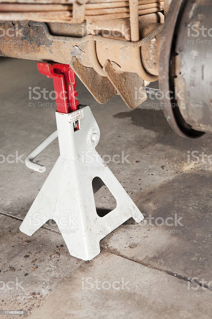 Jack Stand Supports SUV Axle for Brake Repair stock photo