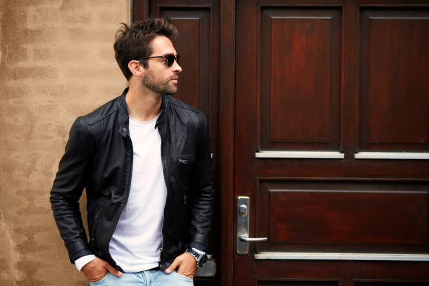 Jacket dude Leather dude in sunglasses, looking away leather jacket stock pictures, royalty-free photos & images