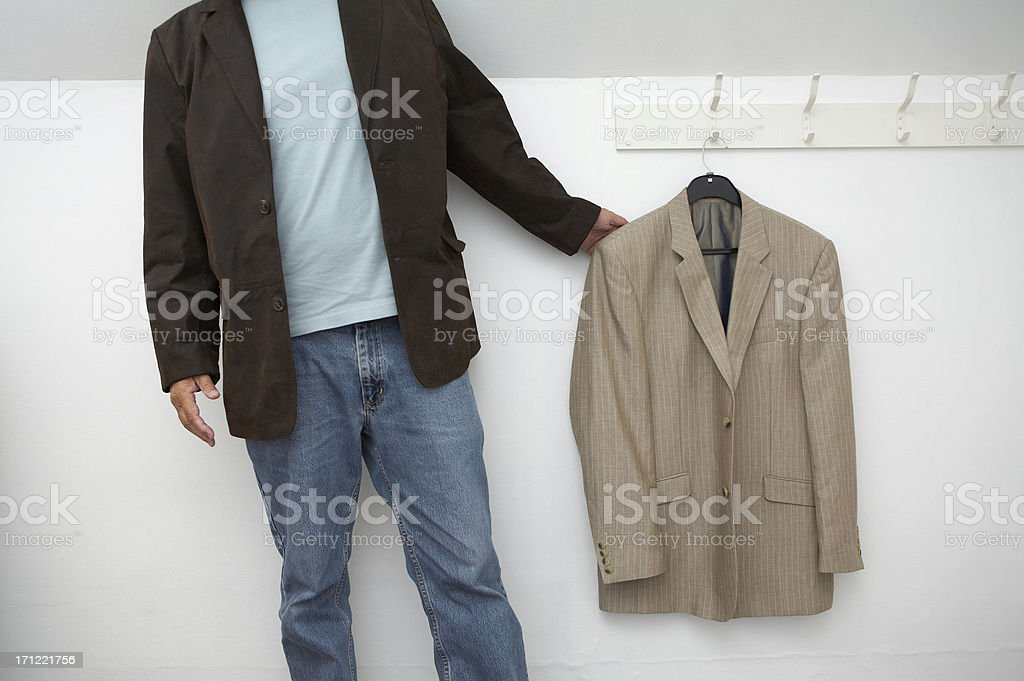 Jacket hanging on the wall and a man stock photo