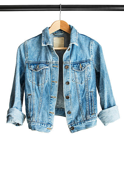 Jacket on clothes rack Blue denim jacket hanging on clothes rack isolated over white coat garment stock pictures, royalty-free photos & images