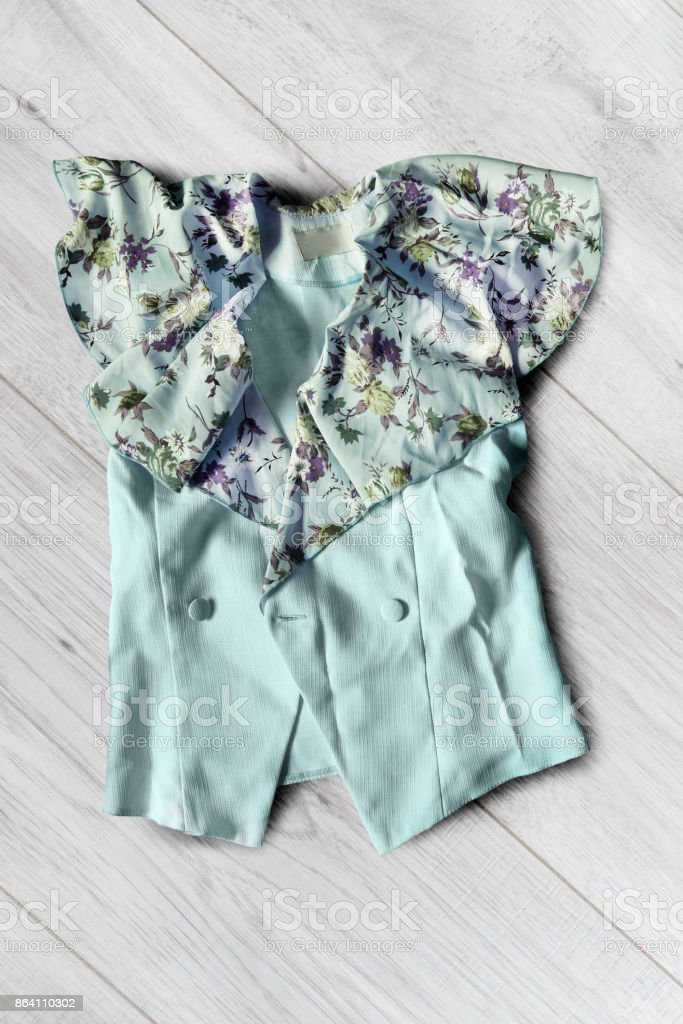 Jacket on wooden background royalty-free stock photo