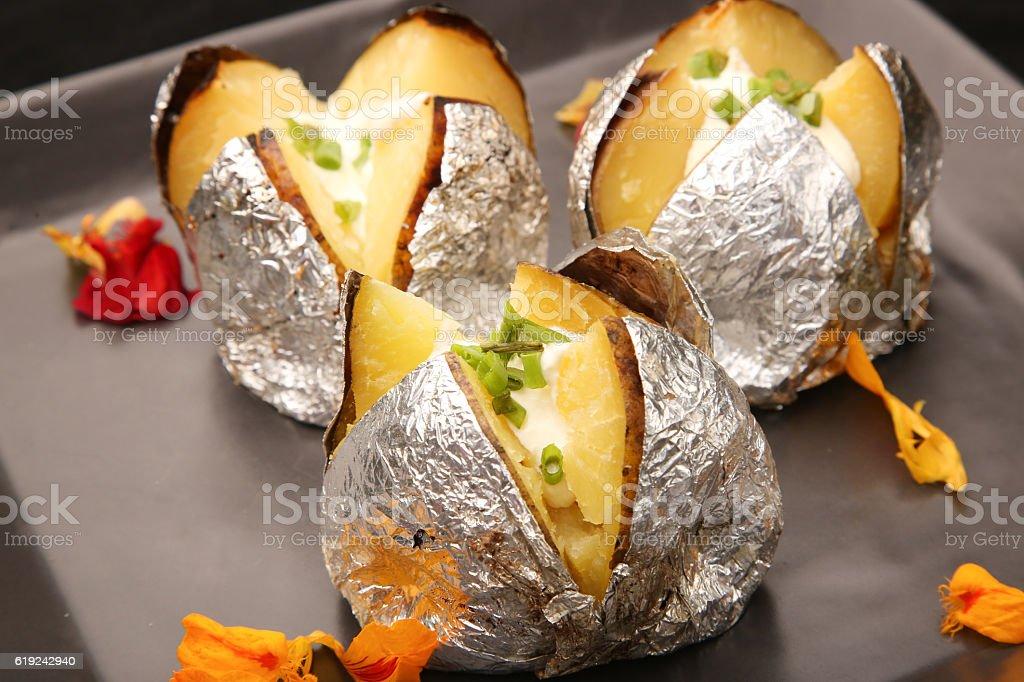 Jacket potato with sour cream stock photo