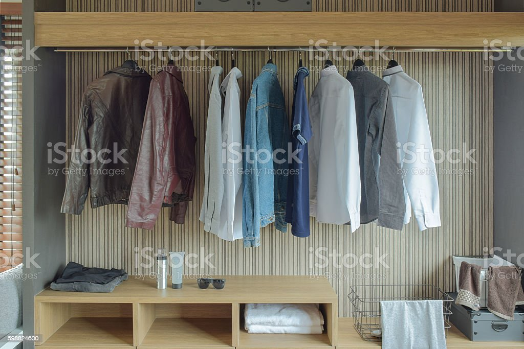 Jackets and shirts in brown color wardrobe - foto de stock