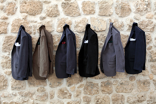 Jackets hanging on wall stock photo