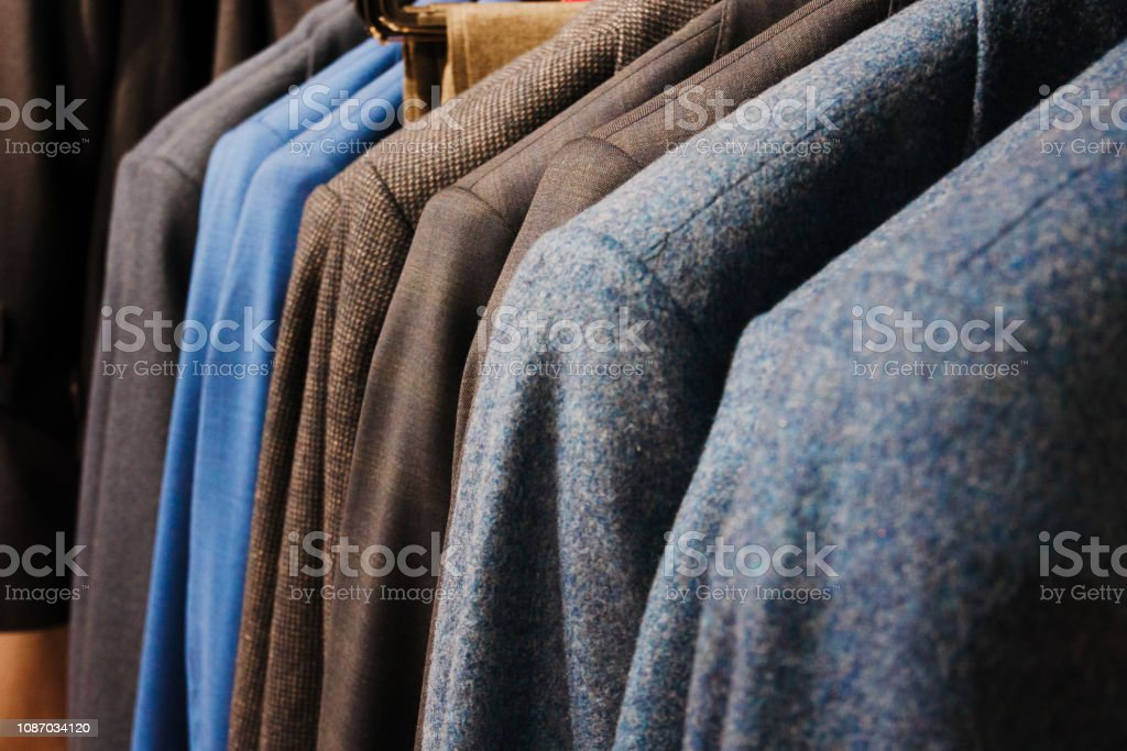 Jackets in men\'s store close up. Hanger in the store.