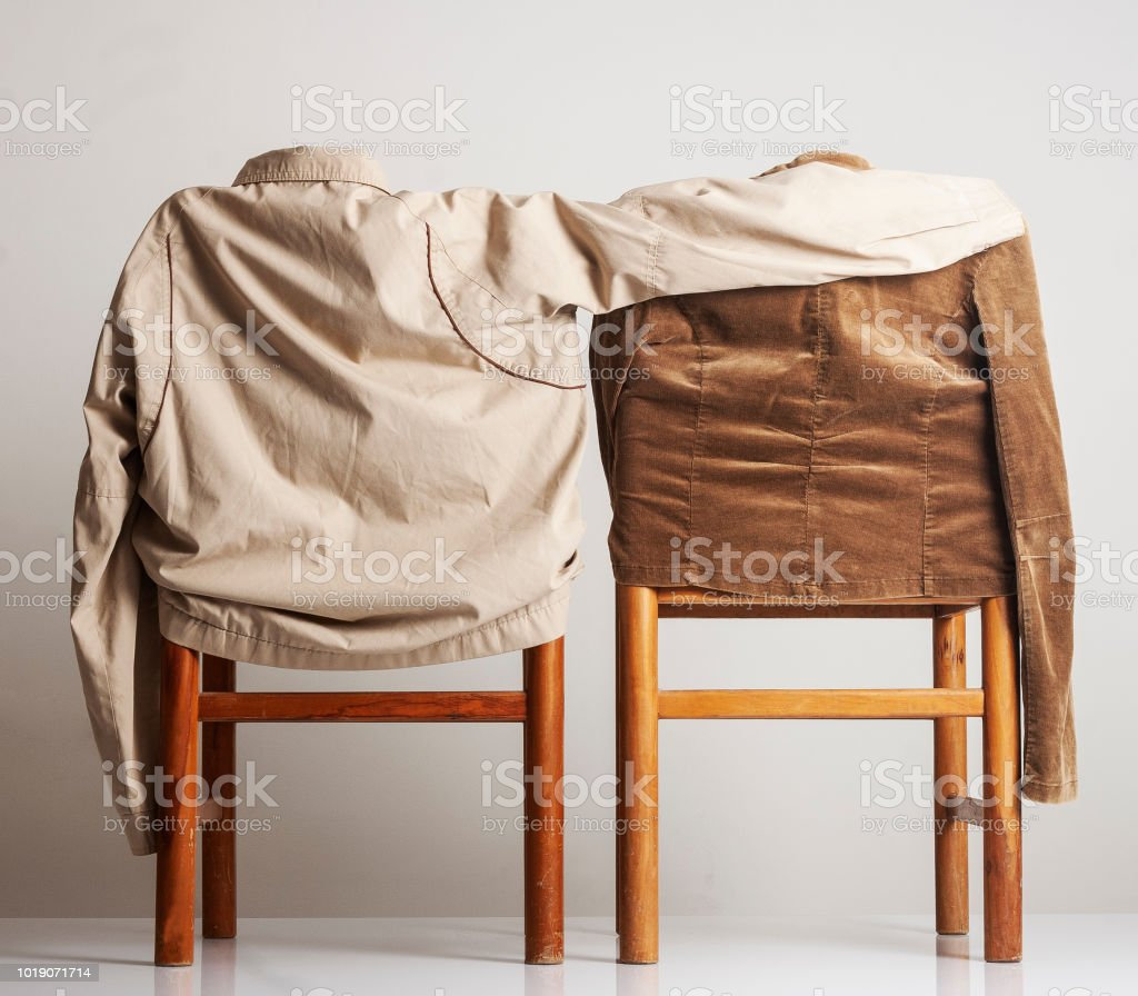 Jackets over chairs stock photo