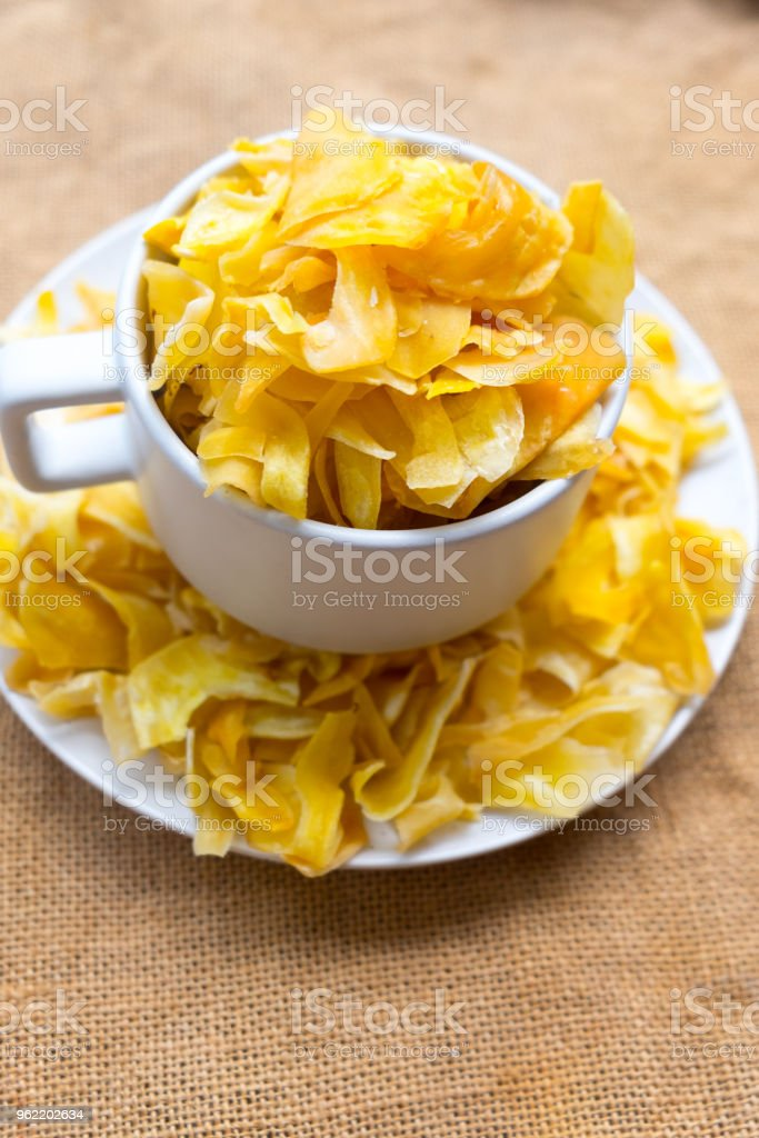 Jackfruit chips in white bowl, Thai snack style stock photo