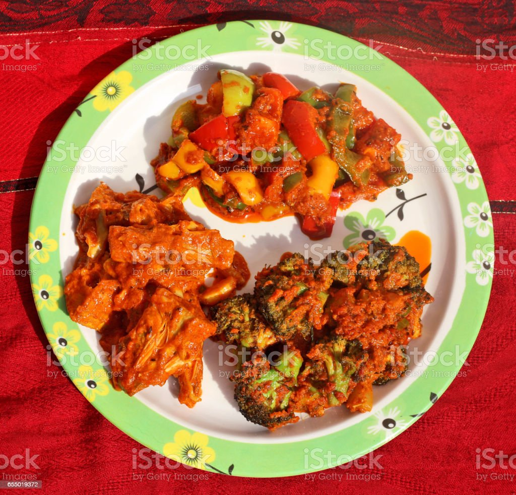 Jackfruit curry, Broccoli curry and tricolour spicy Capsicum curry stock photo