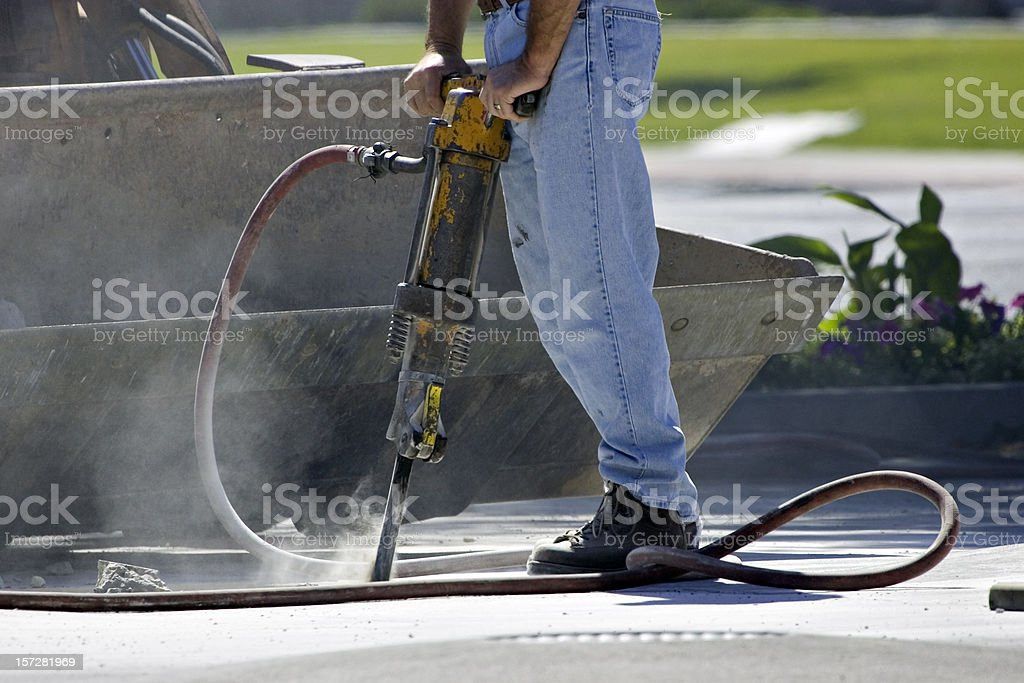 Jack-Hammer Chipping Away One Piece at a Time stock photo