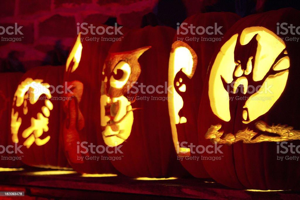 Jack-o-lantern carved pumpkins lit for Halloween stock photo