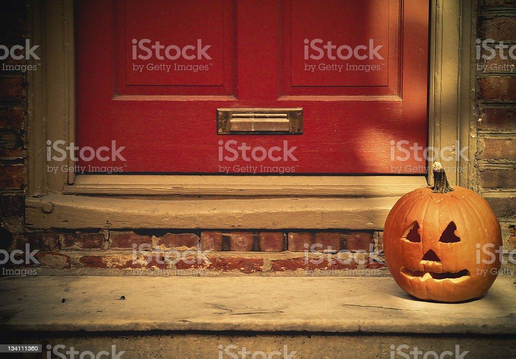 Jack-O'-Lantern On A Doorstep stock photo