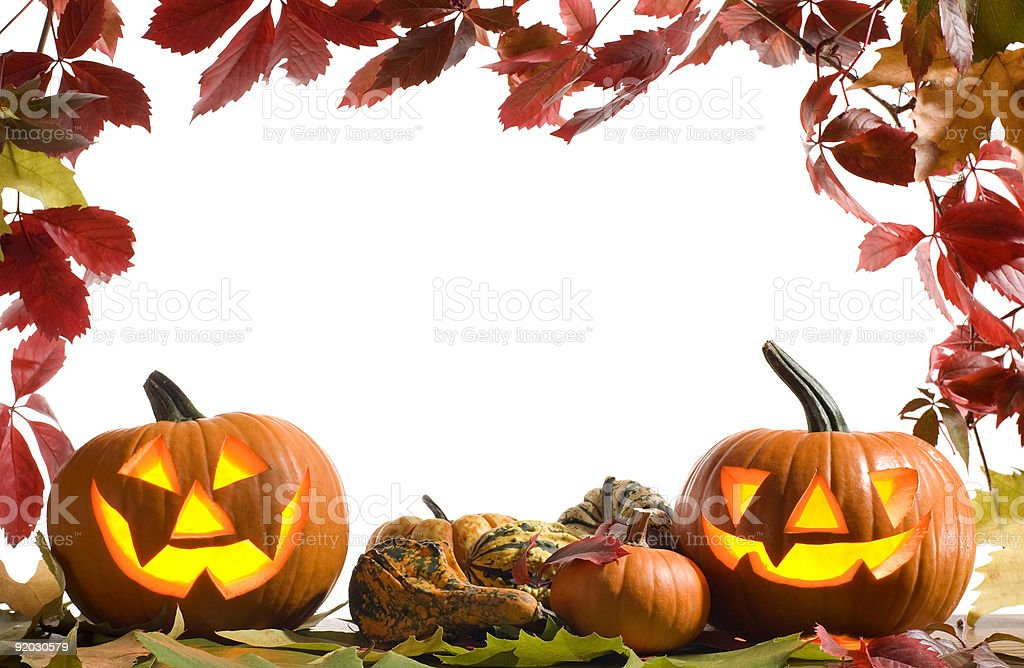 Jack-O-Lanterns and autumn leaves on a Halloween background royalty-free stock photo