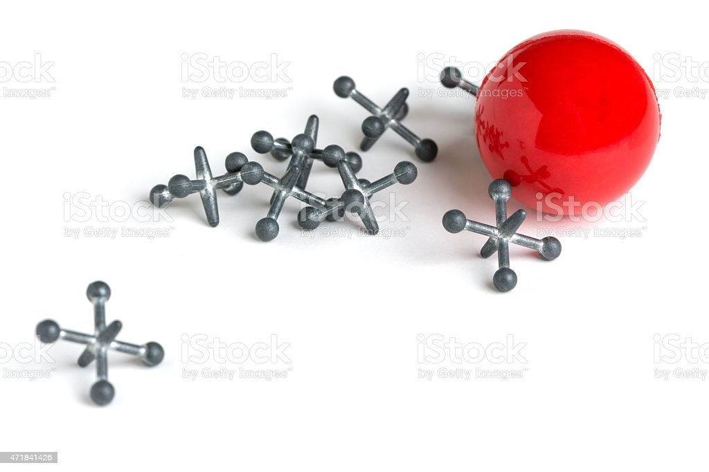Jacks with Red Ball on White Background stock photo