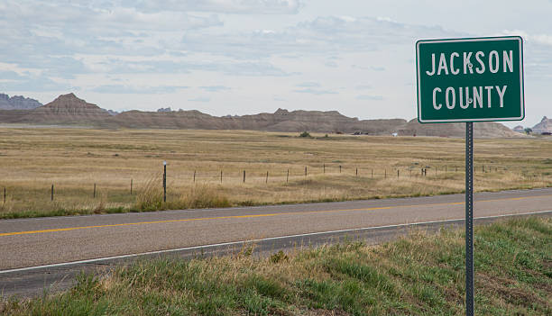 jackson county south dakota highway sign - great plains stock photos and pictures