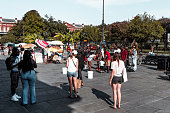 People gathering in Jackson Square around street jazz musicians, New Orleans, Louisiana.