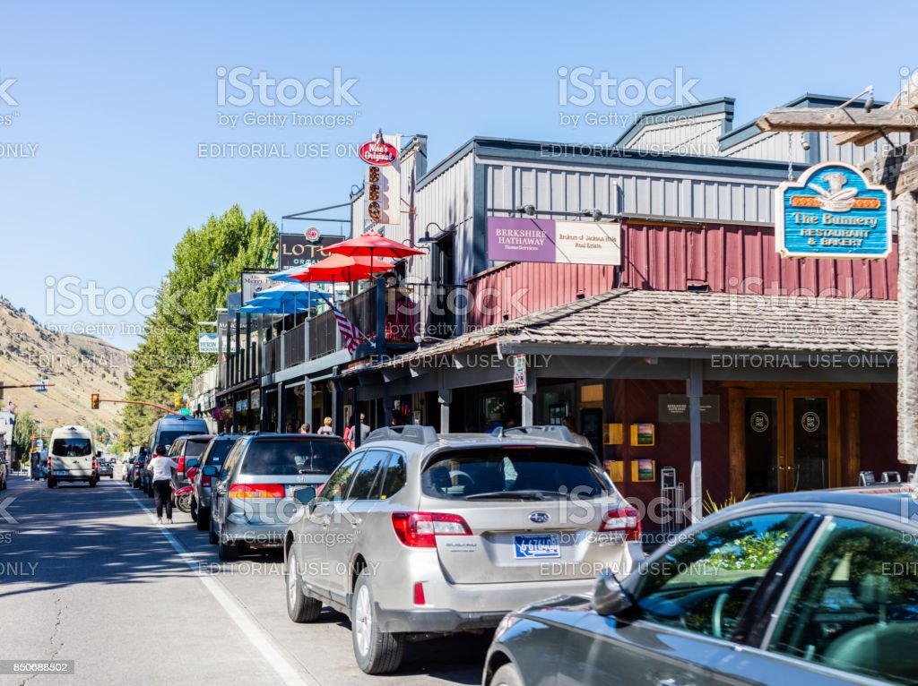 Jackson, Wyoming. Street view with cars, people walking, and building facades stock photo